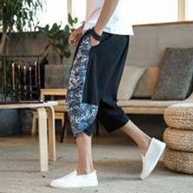 Men Fashion Graphic Print Irregular Loose Cropped Pants