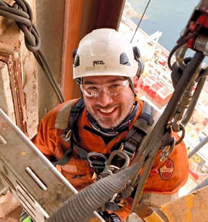 "<img src=""man.jpg"" alt=""life coaching client smiling working on electrics in harness"">"
