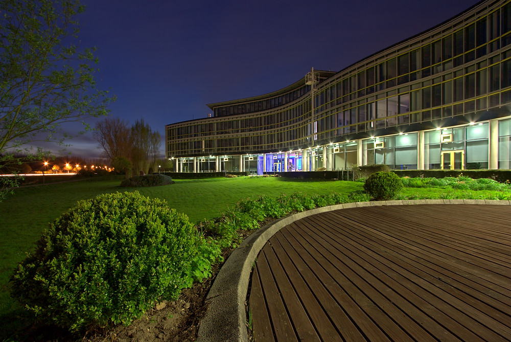 Commercial building in business park at night