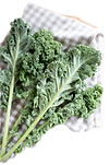 "<img src=""Fresh%20Kale_edited.png"" alt=""fresh kale leaves laid on a blue and white checkered cloth"">"