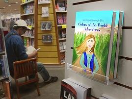 "<img src=""Bookstore Edition 04_01.jpg"" alt=""a man sitting in a bookstore reading a book near shelves"">"