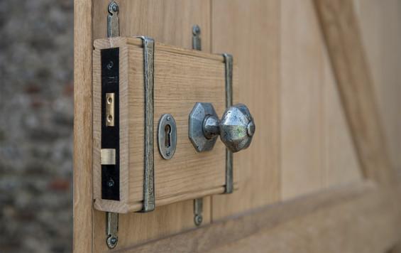 Old style barn lock on oak door