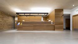 bespoke reception desk, oak cladding walls