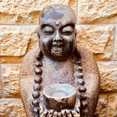 Stone happiness Buddha