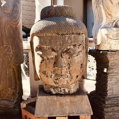 Large stone buddha head on base