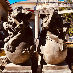 Pair of cast bronze lion on mable base