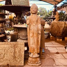 Stone standing Buddha