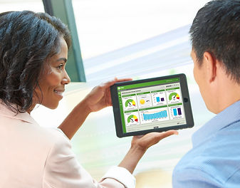 Woman showing man survey results on a tablet