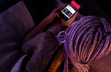 woman-with-purple-braided-hair-holding-a