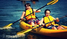 two boys paddling Lake Geneva_edited.jpg