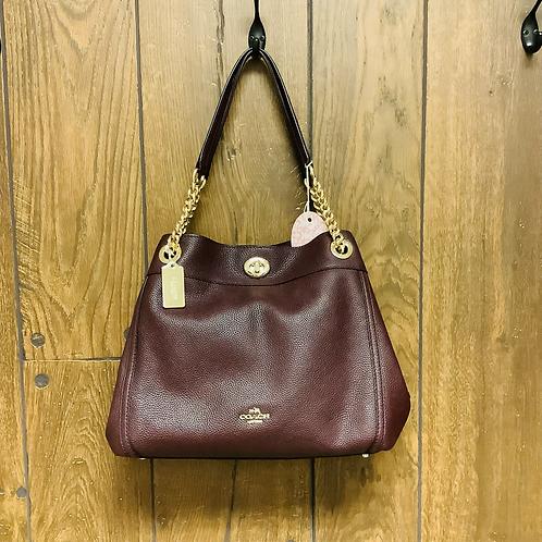Coach burgundy/gold medium size shoulder bag
