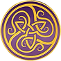 "Ornate gold inlays twist and overlap on a purple coin. ""A"", ""G"", ""K"" can be read."