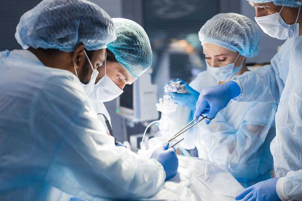 Concentrated Surgical team operating a p