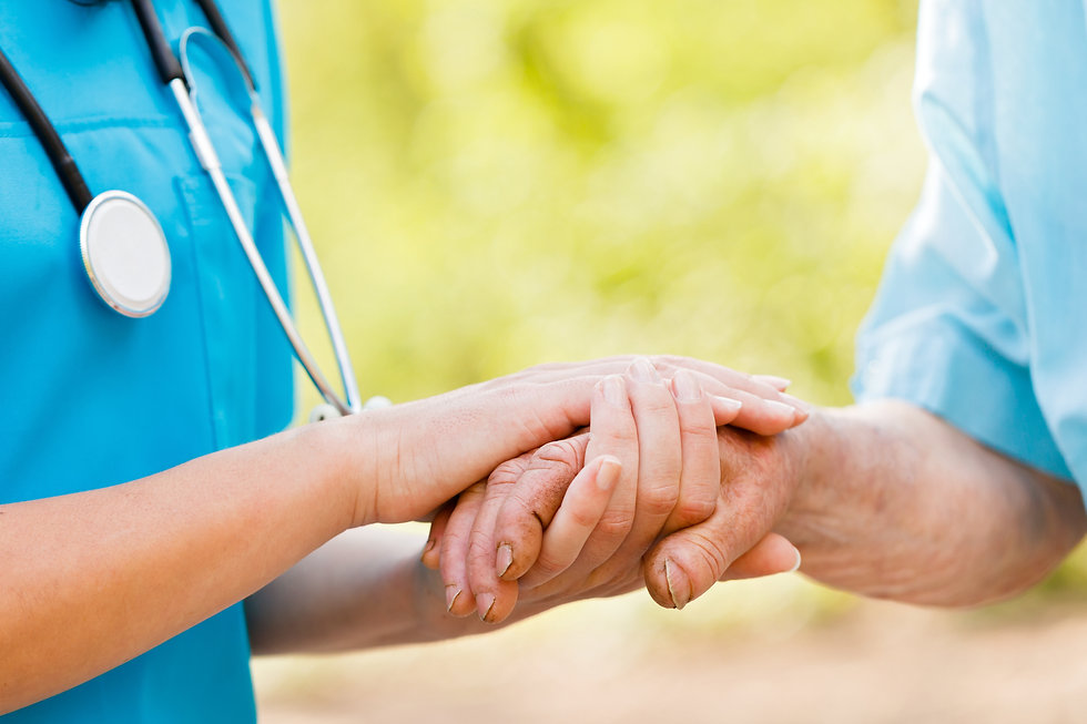 Doctor or nurse holding elderly lady's h