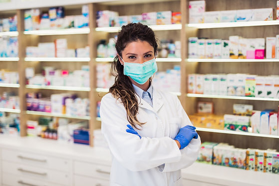 Female pharmacist with protective mask o