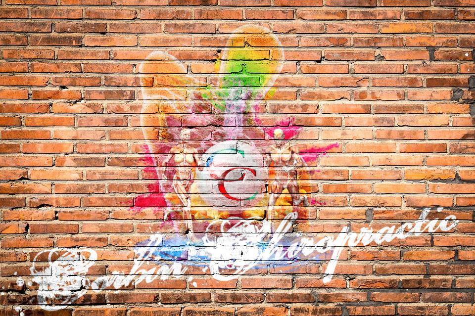 Corbin chiropractic spray paint logo