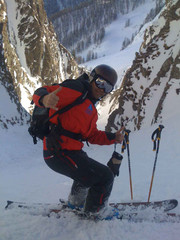 Ski-emg- skiing down a steep couloir in Switserland