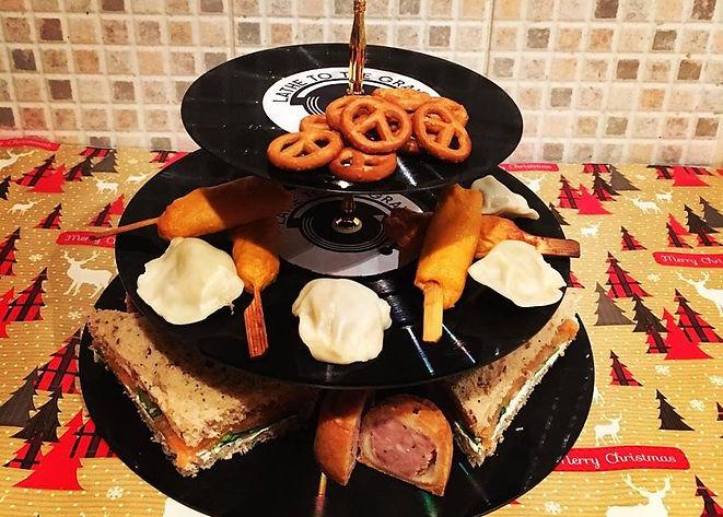cake stand made from upcyled black vinyl records