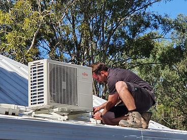 Air conditioning installation in progress in Logan City