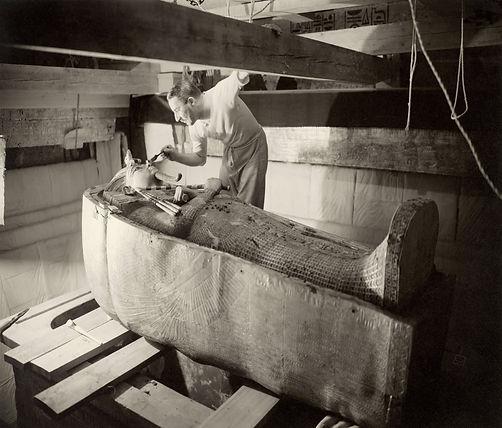 Howard Carter examins the inner coffin.