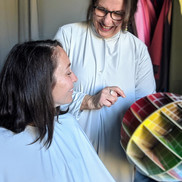Woman with analyst at Personal Colour Analysis at The Colour Clinic