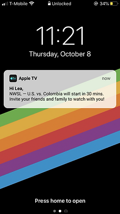 Lea gets an apple tv notification about