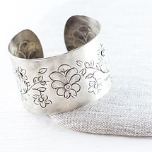 Handcrafted rustic silver bracelets and cuffs