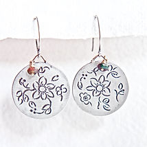 Handcrafted silver earrings. Marcela Colina jewelry.