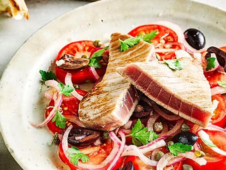 Tuna with marinated tomato and olive salad