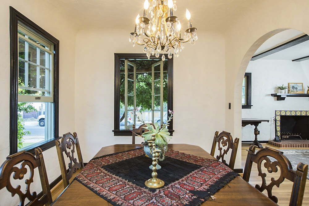 A vintage brass chandelier over the dinning room replaces a ceiling fan.