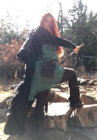 A fan cosplaying Taliesin.