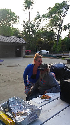 """Chaplain Tammy Ingram and Founder of Blameless and Forever Free Ministries pouring love into our friends in need (homeless population) during their street outreach and dinner events called """"A Beautiful You.""""  Martin is no longer homeless; thank you, Jesus!"""
