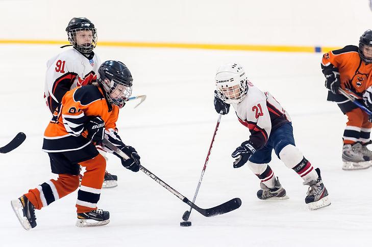 Game between children ice-hockey teams.j