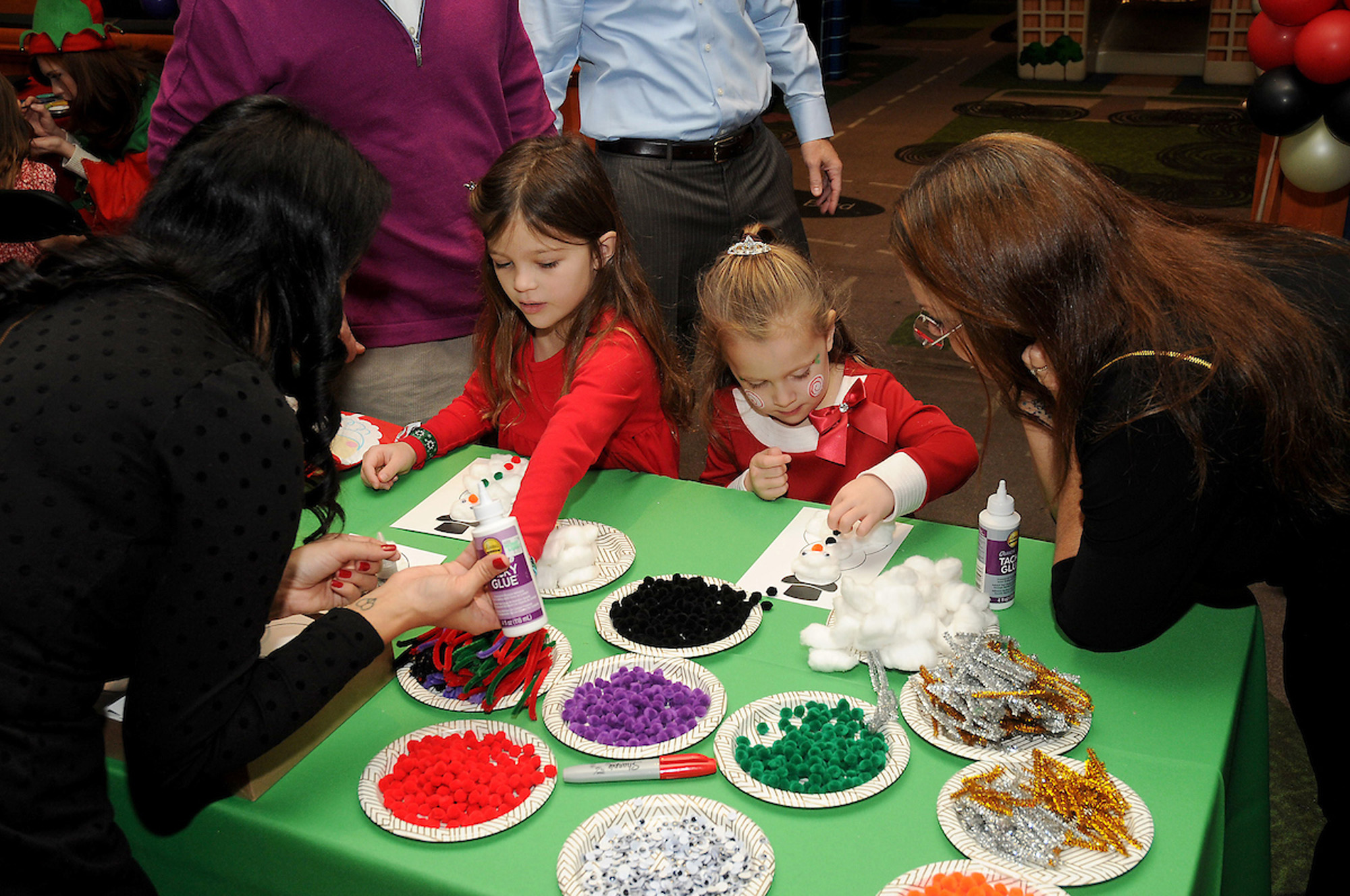 Children make a snowman at the M.D.Anderson Breakfast with Santa