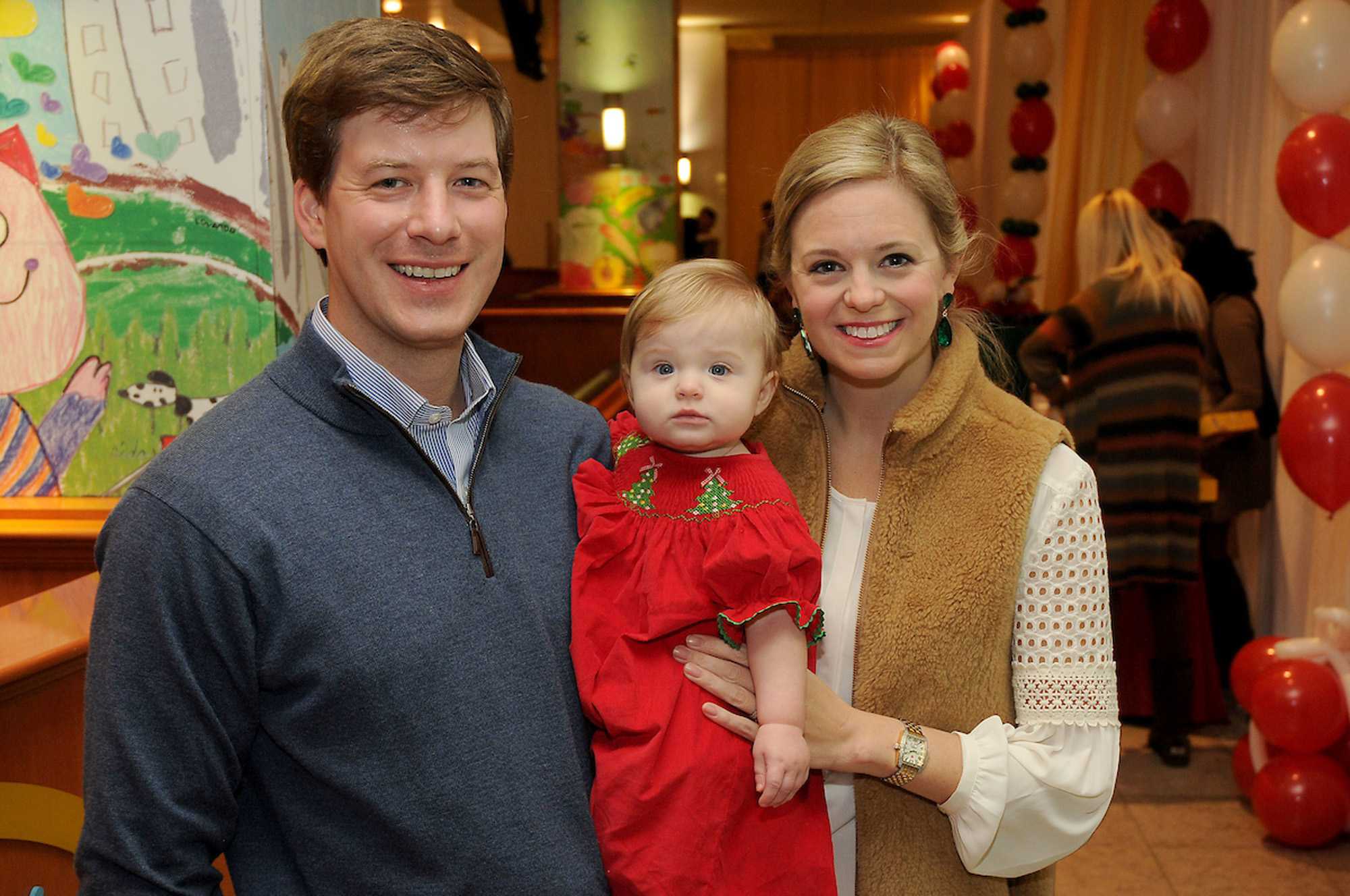 Sarah and Travis Covington with their daughter Carter