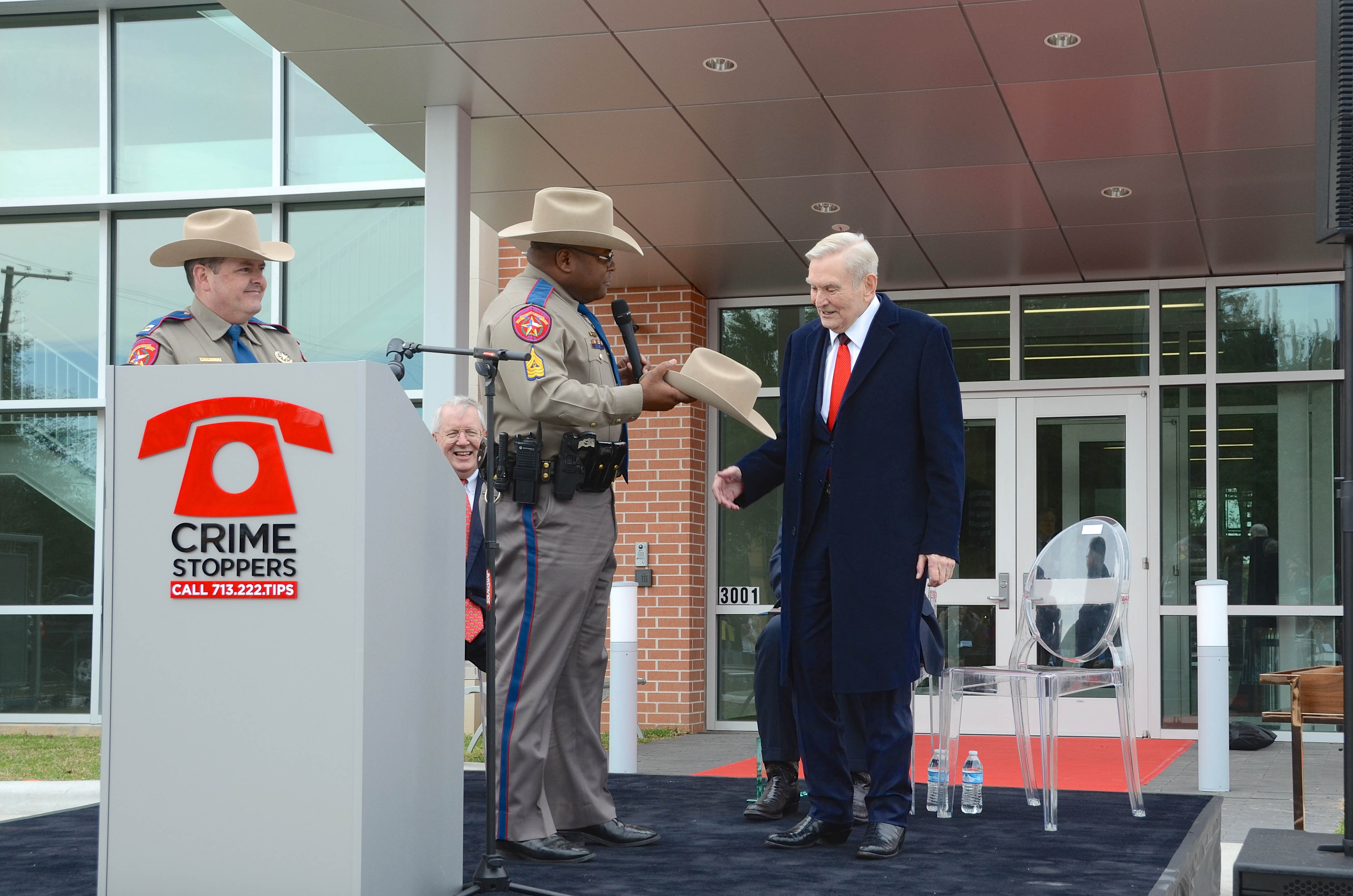 Texas State Trooper Sergeant Woodard presenting Dave Ward with official Texas Trooper cowboy hat