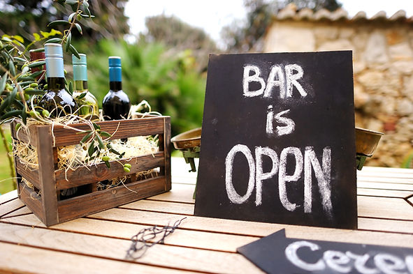 Bar is open sign and vintage wooden crat
