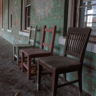 Brigham Building Chairs on Porch