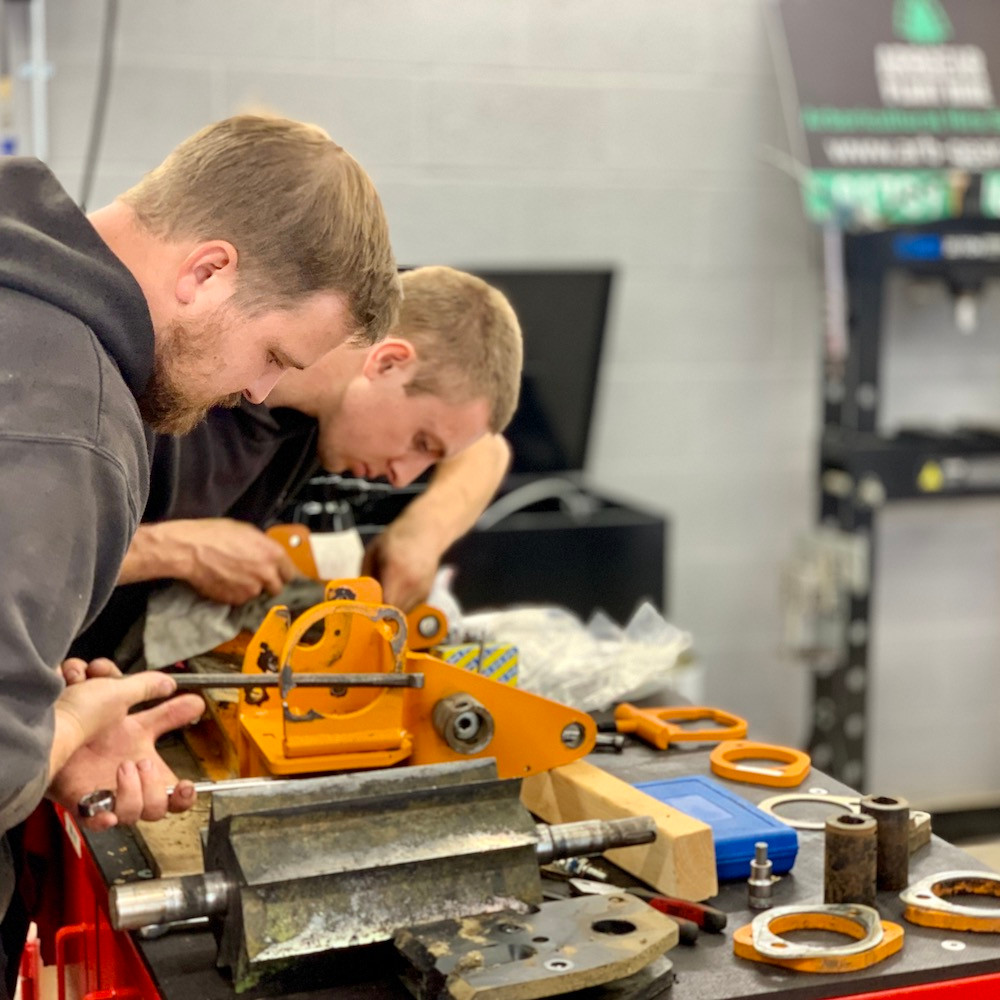 arbgear engineers working on a forst wood chipper
