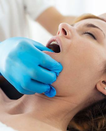 young-physiotherapist-doing-a-face-treat