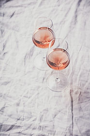 rose-wine-and-roses-on-white-background-