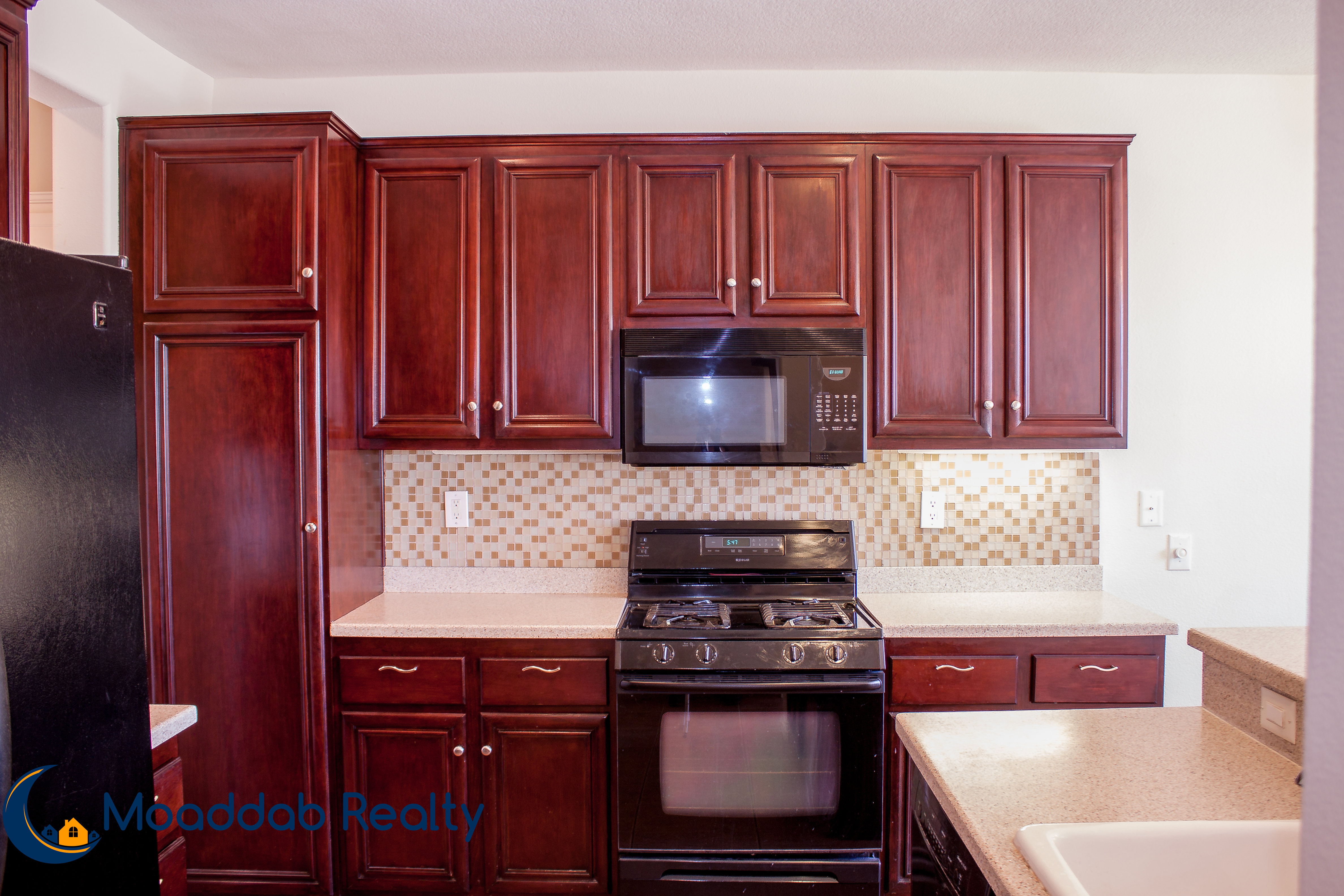 Cherry Wood Cabinets with Backsplash