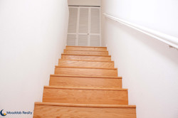 Staircase to the Dual Master Suites