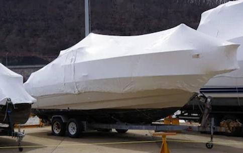 shrinkwrapped-boats-stored-ashore-winter