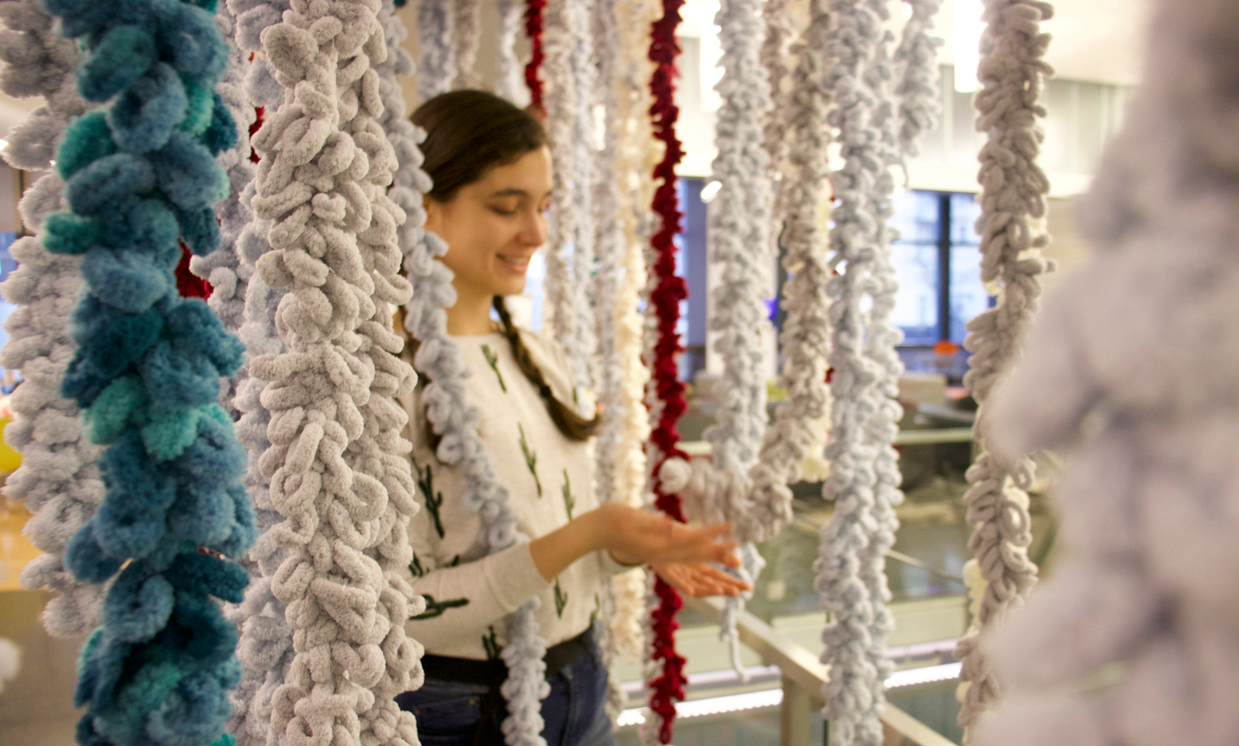 Bells are attached at the end of the yarns. As they walk through the installation, the bells ring to add onto the otherworldly atmostphere of the overall experience.