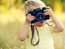 Young child taking a picture