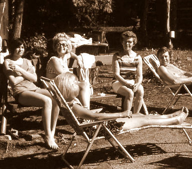 group of people socializing and sunbathing