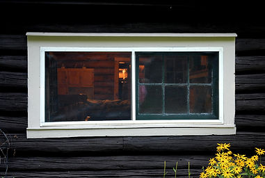 Log cabin exterior window frame