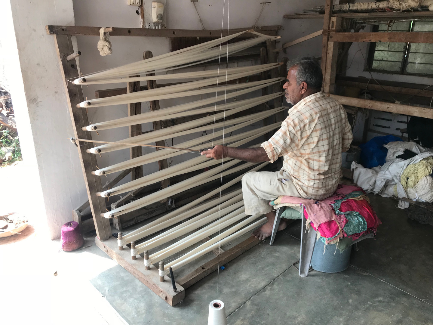 Sorting the threads before setting up the loom.