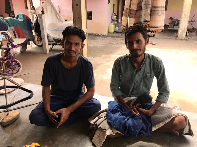 These brothers are making some. of our hand woven kala cotton fabric and shawls.